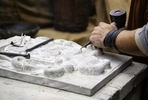 Carving stone in a traditional way photo