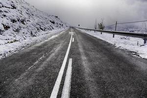 Snowy mountain road in winter photo