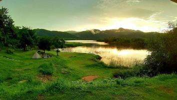 The camping ground, Ratchaburi, Thailand. landscape with mountains, forest, and a river in front. beautiful scenery. photo
