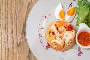 Shrimp fried rice with salt egg on plate photo