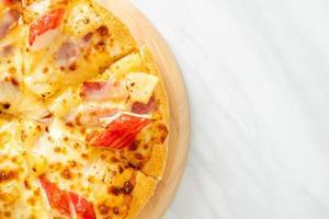 Ham and crab stick pizza or Hawaiian pizza photo