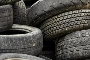 Old car tires in a dump photo