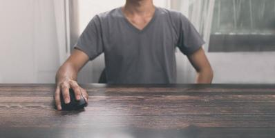 Man using computer mouse photo