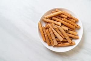 Crispy coconut roll - a type of rolled wafer, a traditional dessert in Thailand photo