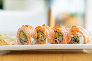 Salmon roll sushi with sauce on top - Japanese food style photo