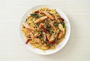 Homemade spaghetti with garlic and sausage photo