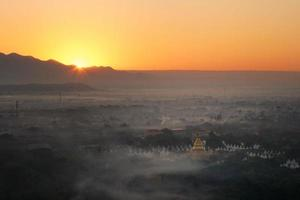Top view of Mandalay city from Mandalay hill at the sunrise time that the sky turned orange photo