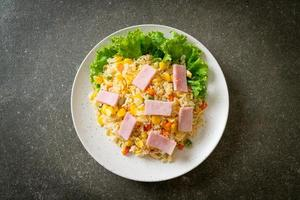 Homemade fried rice with ham and mixed vegetables of carrot and green bean peas photo