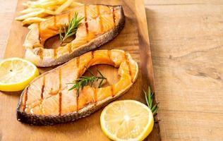 Grilled salmon steak fillet with lemon photo