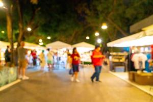 Abstract blur and defocused night street market for background photo