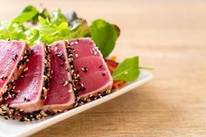 Fresh tuna raw with vegetable salad - healthy food photo