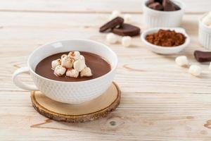 Hot chocolate with marshmallows in cup photo