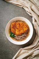 Soba ramen noodle with Japanese fried pork cutlet, or tonkatsu - Asian food style photo