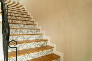 Beautiful stair steps with black handrail photo