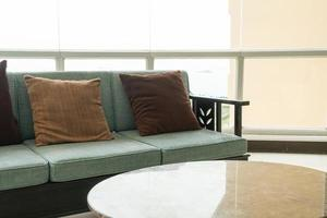 Empty sofa and chair with pillows decoration in a room photo