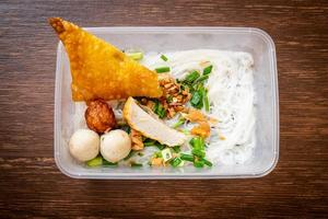 Noodles with fish ball and minced pork in delivery box - Asian food style photo