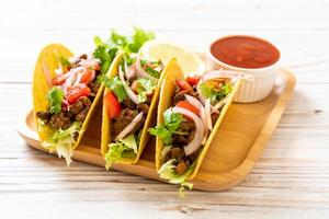 Tacos with meat and vegetables - Mexican food style photo