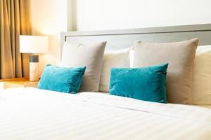 Comfortable pillow decoration on bed in bedroom photo