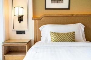 Comfortable pillows decoration on bed in hotel bedroom photo