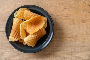 Butter and milk crispy waffle on plate photo