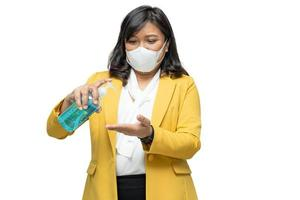 Business woman press blue alcohol sanitizer gel isolated on white background with clipping path to new normal after COVID-19 coronavirus pandemic. photo