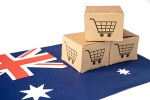 caja con el logotipo del carrito de compras y la bandera de australia, importación, exportación, compras en línea o comercio electrónico, servicio de entrega de finanzas, tienda, envío de productos, comercio, concepto de proveedor. foto