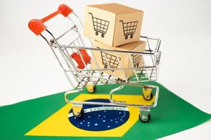 Box with shopping cart logo and Brazil flag, Import Export Shopping online or eCommerce finance delivery service store product shipping, trade, supplier concept. photo