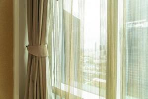 Beautiful curtain with window and sunlight photo