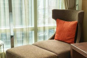 Beautiful pillow decoration on sofa bed near window with sunlight photo