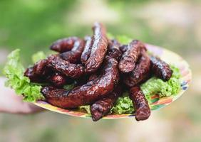 Grilled sausages on a plate photo