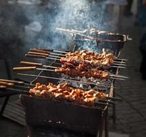 Meat shish kebab on the grill. traditional outdoor barbecue picnic. grilled meat bbq photo