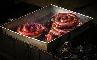 Pork sausage fried in oil photo