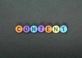 small round cubes colored with the word content photo