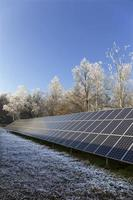 Solar Power Station in the snowy freeze winter Nature photo
