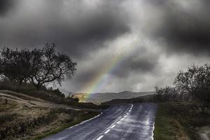 Mountain road with a storm background photo