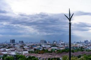 Lightning rod on the rooftop of condominium with cloudy sky photo