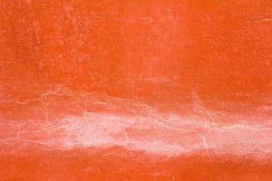 Muro de hormigón de color naranja con el fondo de la grieta foto