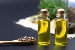 Hemp seeds and hemp oil, CBD cannabis oil extract, marijuana  alternative herbal medicine concept. photo