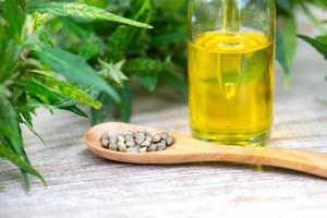 Hemp oil, Marijuana oil bottle, cannabis oil extracts in jars, medical marijuana, CBD oil pipette. photo