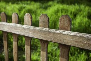 Wooden fence in a garden photo