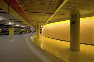 Illumination and light signaling in an underground parking of a shopping center, Spain photo