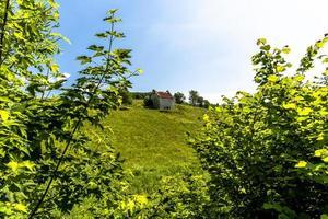 Abandoned farmhouse on a hill photo