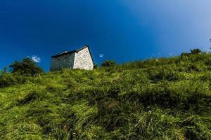 Old farm on a hill photo