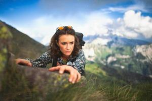 Beautiful sporty girl in a mountain pass. Vintage style photography photo