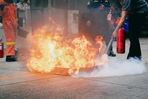 Employees firefighting training,Extinguish a fire. photo