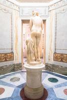 Roman antique statue of Capituline Venus in marble. Rome, Italy photo