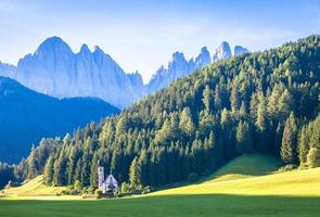 View of the small church of St. John in Ranui, Dolomites mountain, photo