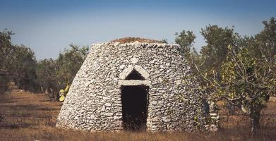 Puglia Region, Italy. Traditional warehouse made of stone photo