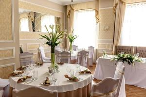 Beautiful decoration of the wedding holiday with flowers and greenery with florist decoration photo
