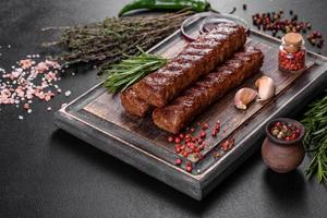 Fresh tasty kebab grilled with spices and herbs photo